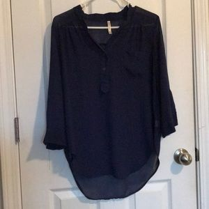 Navy blue see through shirt.